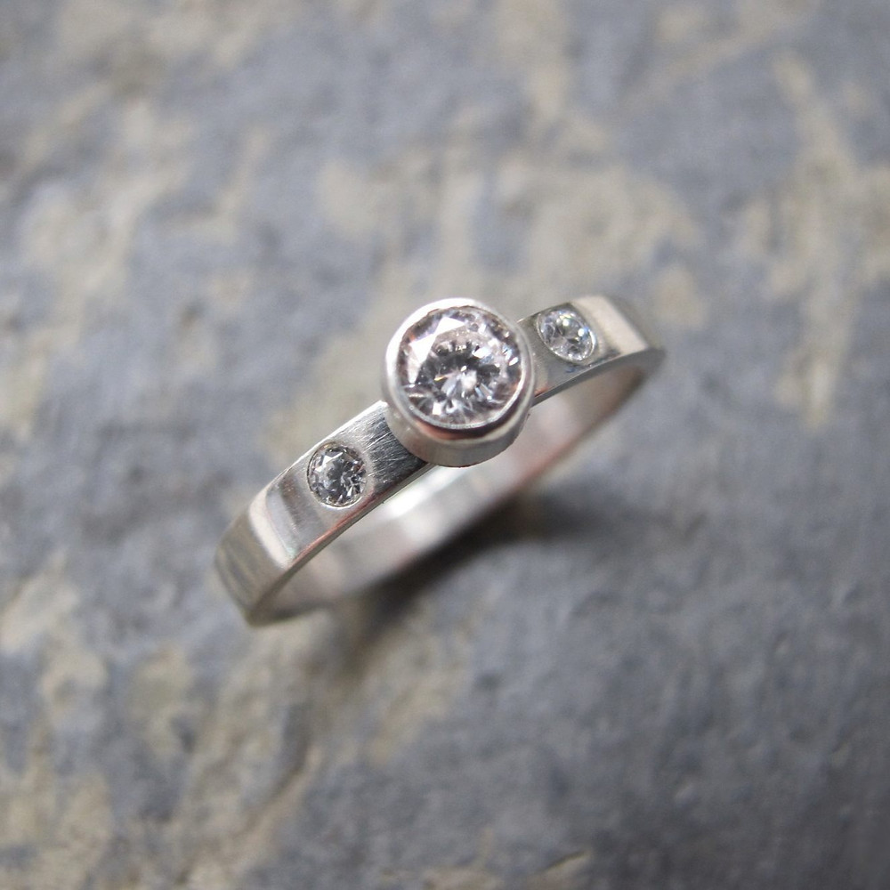Trilogy diamond ring three stone engagement ring