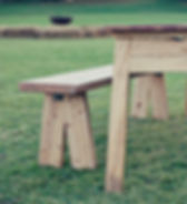 Close up of a bench and rustic table leg