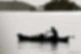 Silhouette of fishing canoe