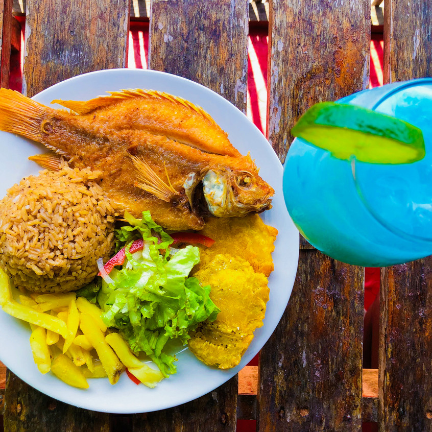 Fried snapper meal with a blue coco