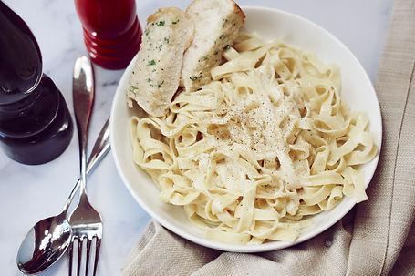 Fettuccine alfredo made with fresh pasta & homemade alfredo sauce