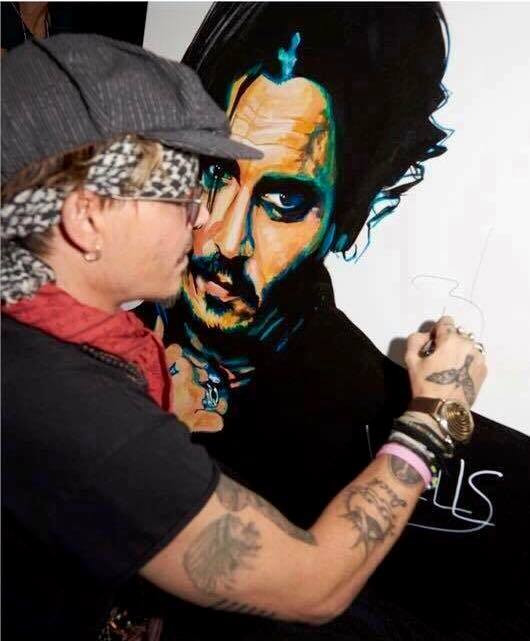 Johnny Depp signs a WELLS original