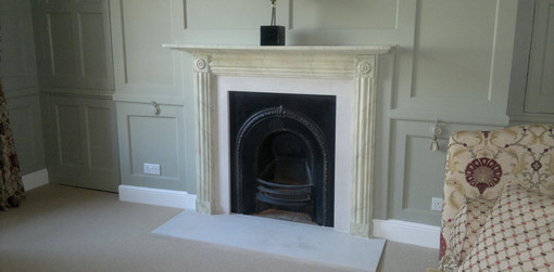 Fireplace hand painted using the faux grey marble paint effect technique