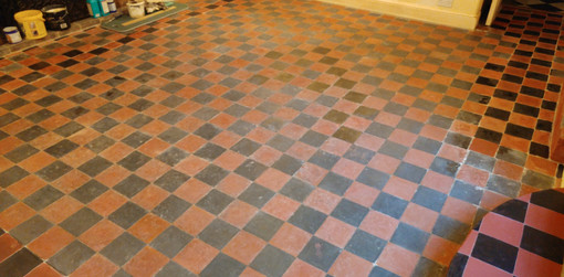 Faux stone paint effect used to repair an old tile floor