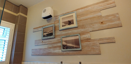 Hand painted drift wood paint effect feature for a bathroom wall