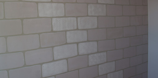 Faux stone hand painted bedroom wall