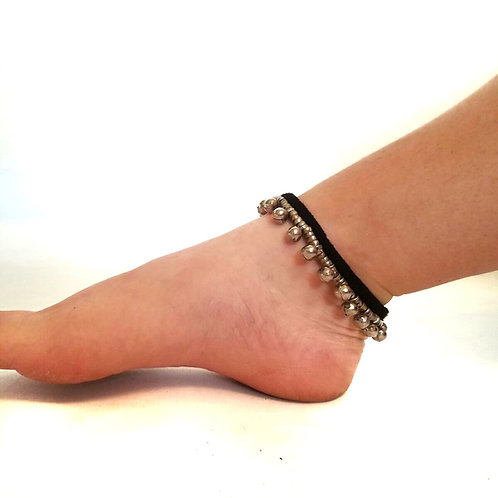 PAIR OF SILVERY BELL ANKLETS ON BLACK SHOE LACE