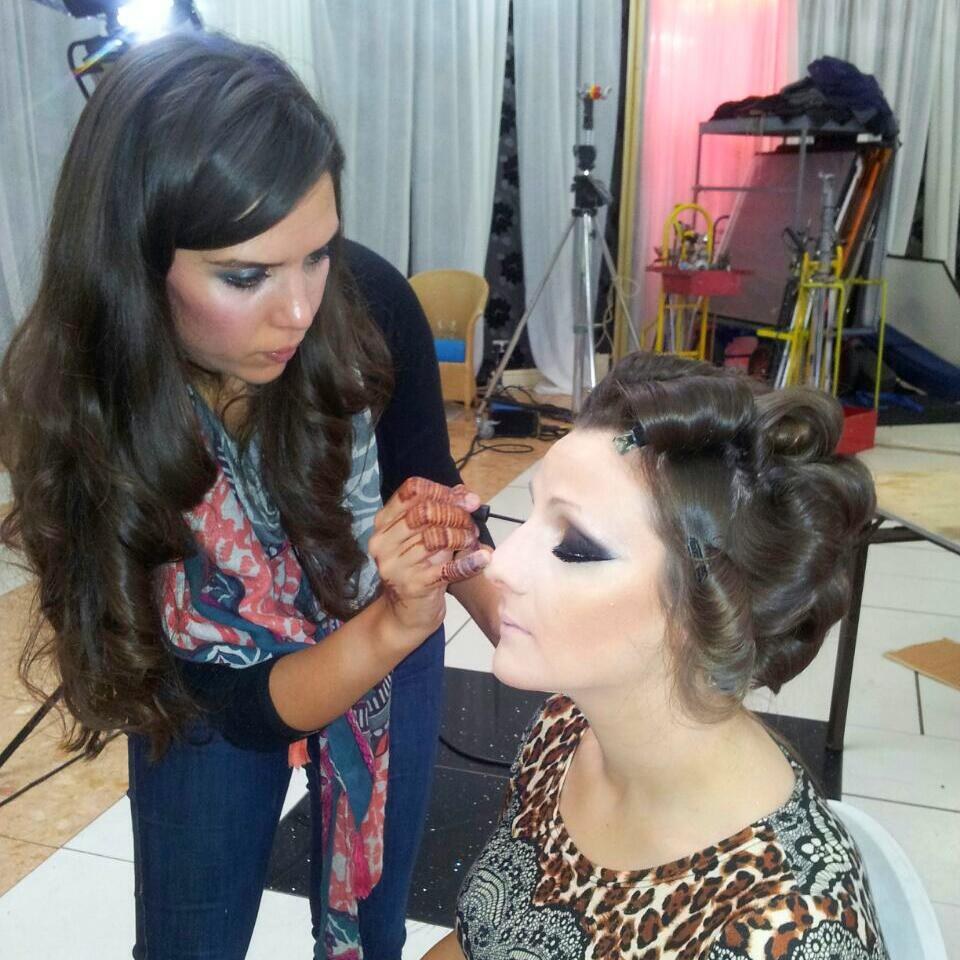 Getting her make up done