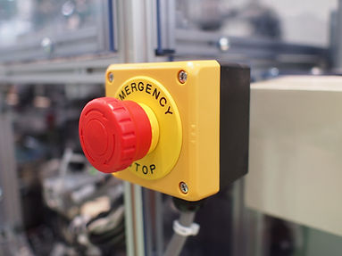 image of an emergency stop button installed in a factory