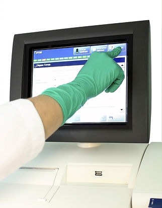image of a hand using a HMI control panel