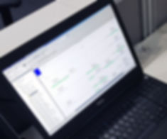 image of PLC programming software shown on a laptop screen