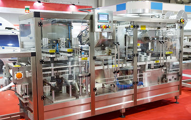 image of a packing machine used in a manufacturing area