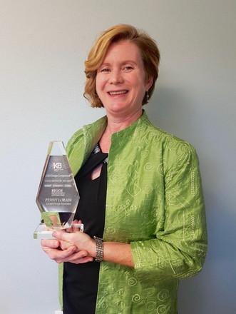 Penny Lorain with Award