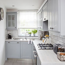 Small-l-shaped-kitchen-with-pale-cabinet