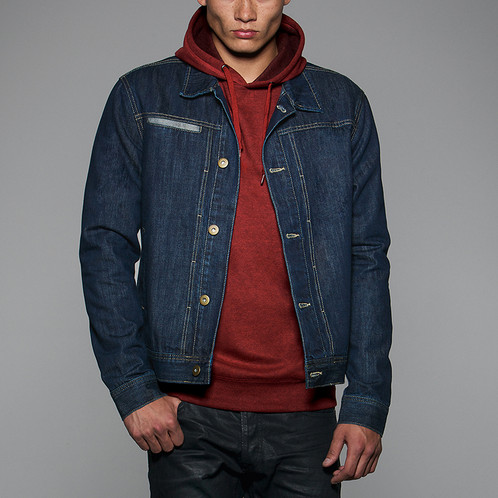 dd31a5186d8 Men's iconic and fashionable denim trucker jacket. 100% denim cotton,  garment wash. Metallic buttons in antique brass. Front folding with  bartacks to ...