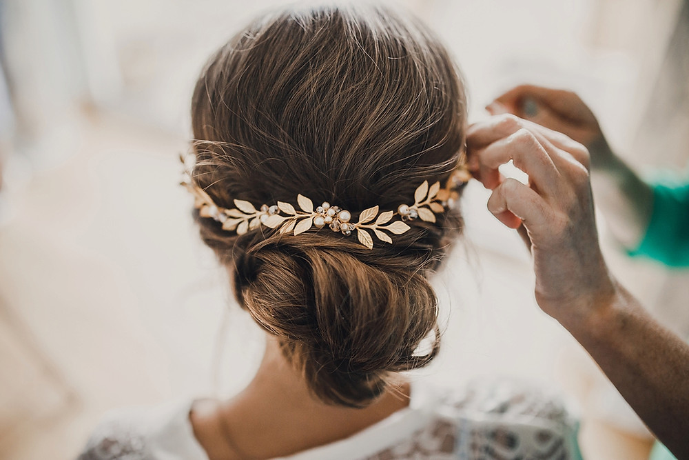 soft updo bridal hair vine gold leaves