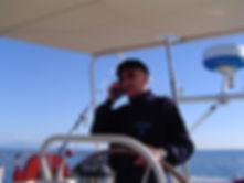 Antonio Gades al timone del LUAR 040 con la maglia logata