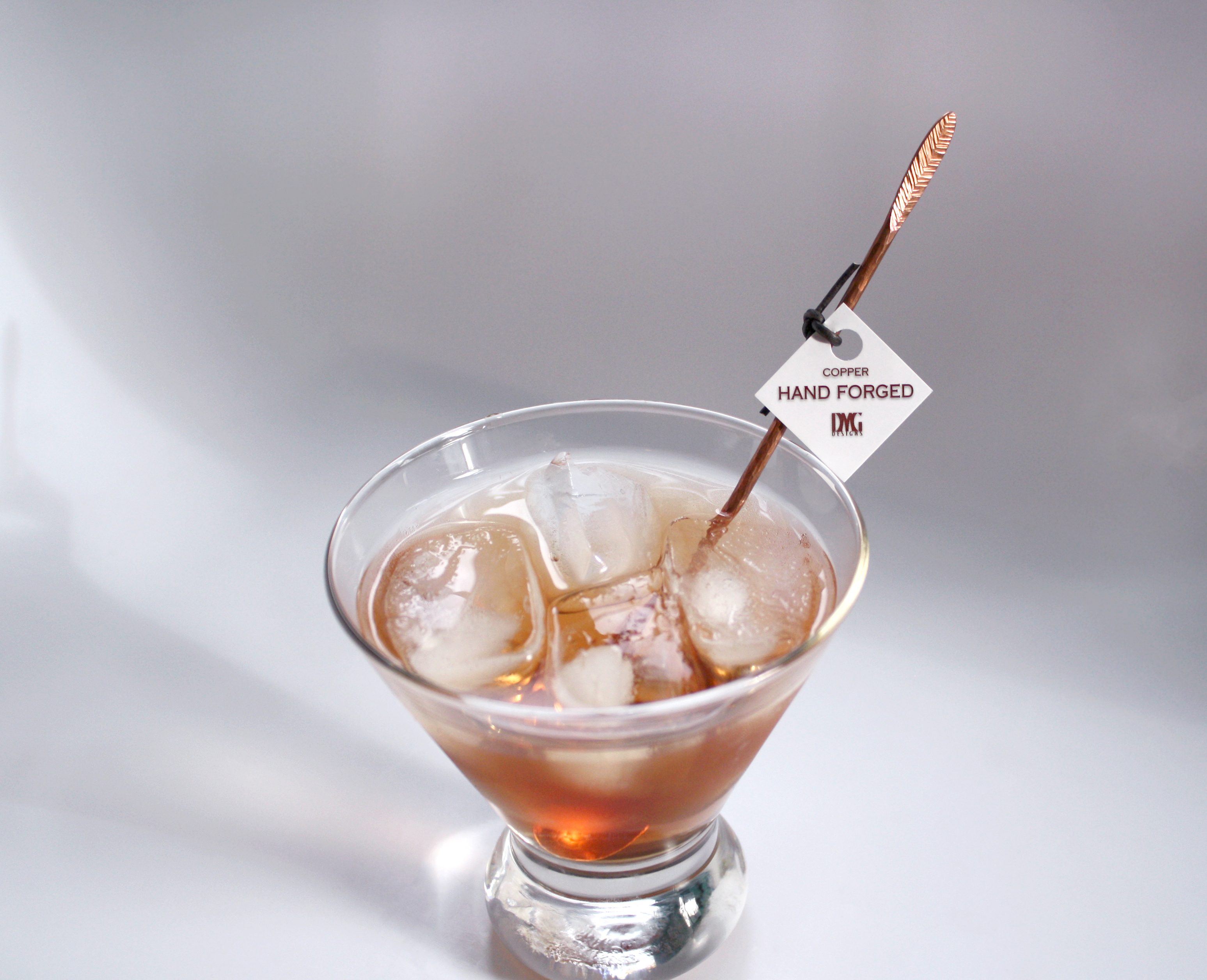 Stirrer with tag in drink