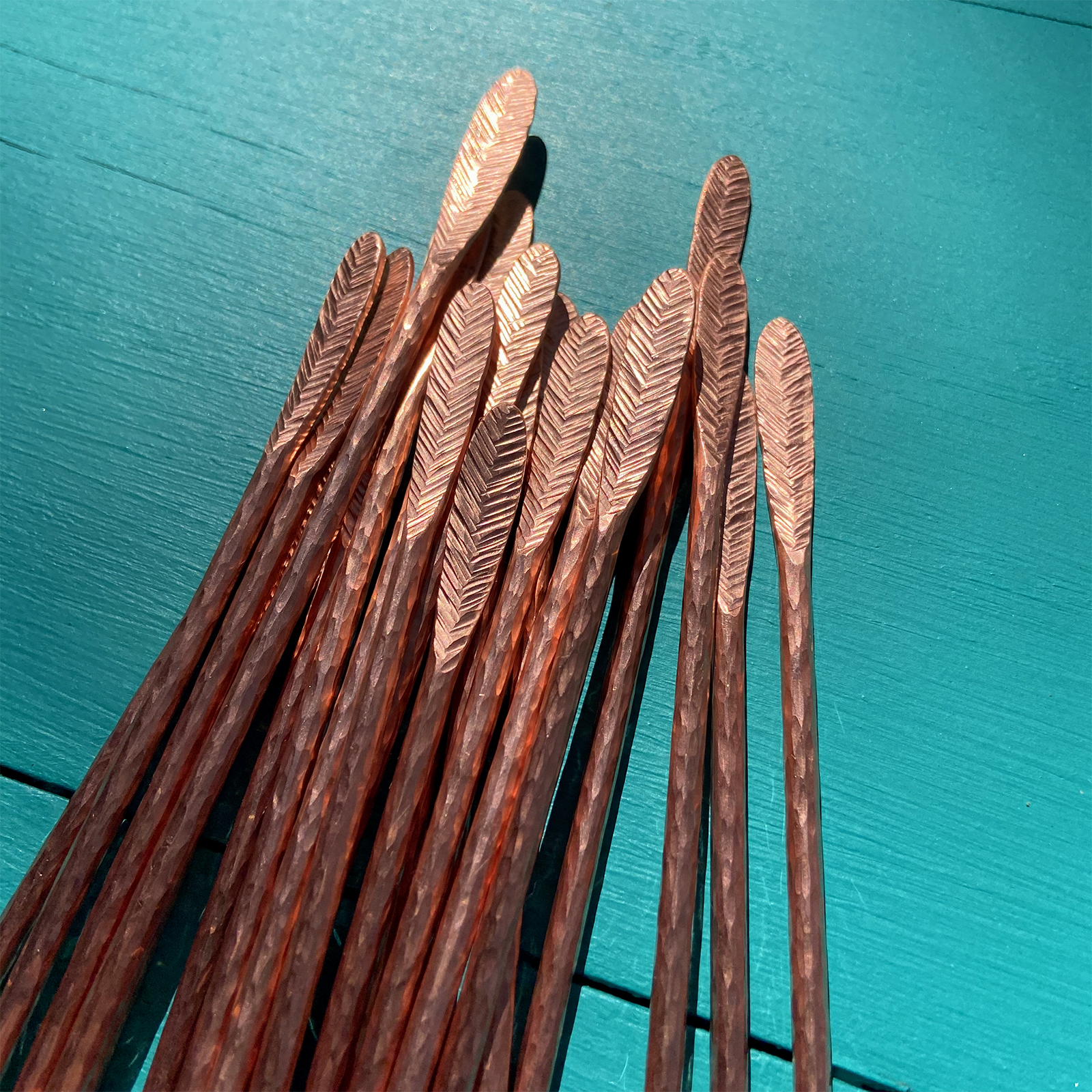 Feather ends of cocktail stirrers