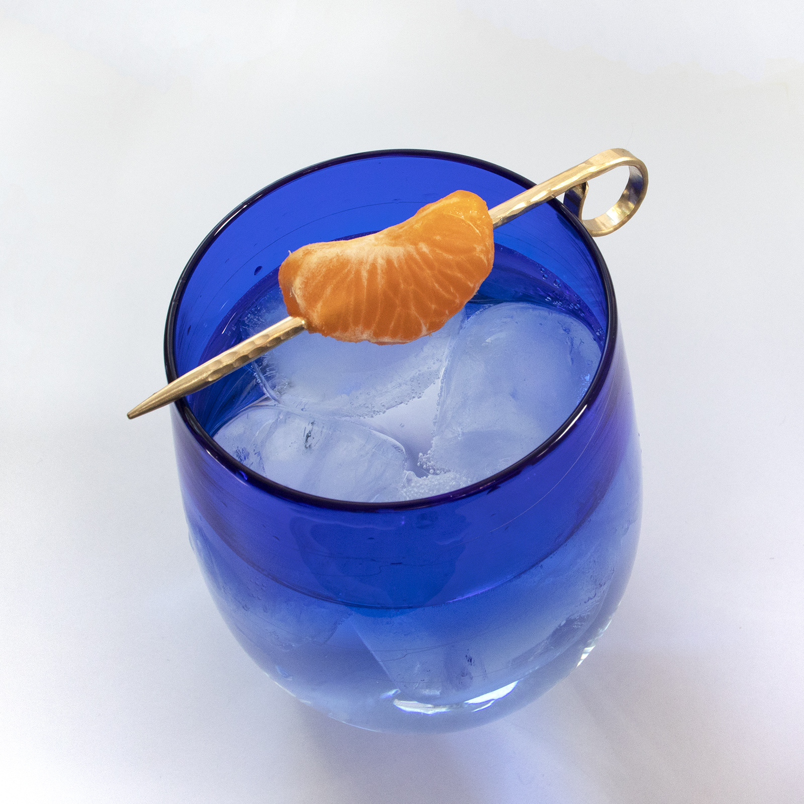 Brass cocktail pick in blue glass - clem