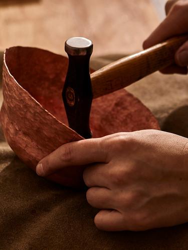 Hammering copper bowl.jpg