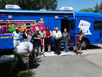Ribbon Cutting for Bells for Books Bus.