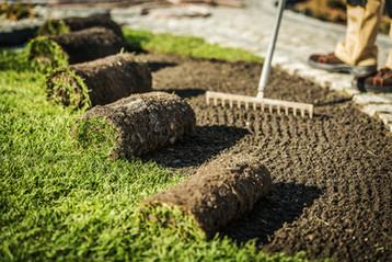 lawn-care-contractor-prepares-area-for-s
