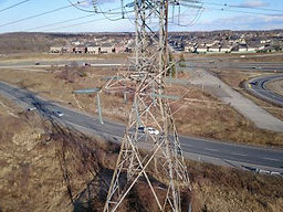 Aerial drone image of a steel tower bein