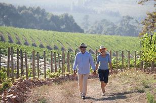 Couple walking vineyard