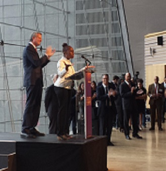 Mayor Bill de Blasio and First Lady Chirlane McCray addressing the crowd.