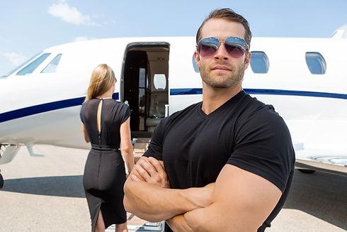 Confident bodyguard wearing sunglasses w
