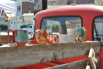Mugs on the iconic Red River Market truck
