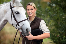young woman taking care of her horse.jpg