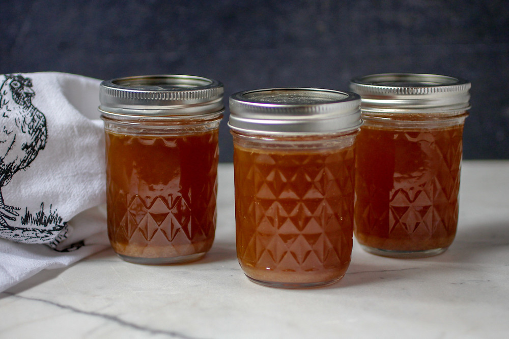 Easy chicken bone broth in glass freezer jars