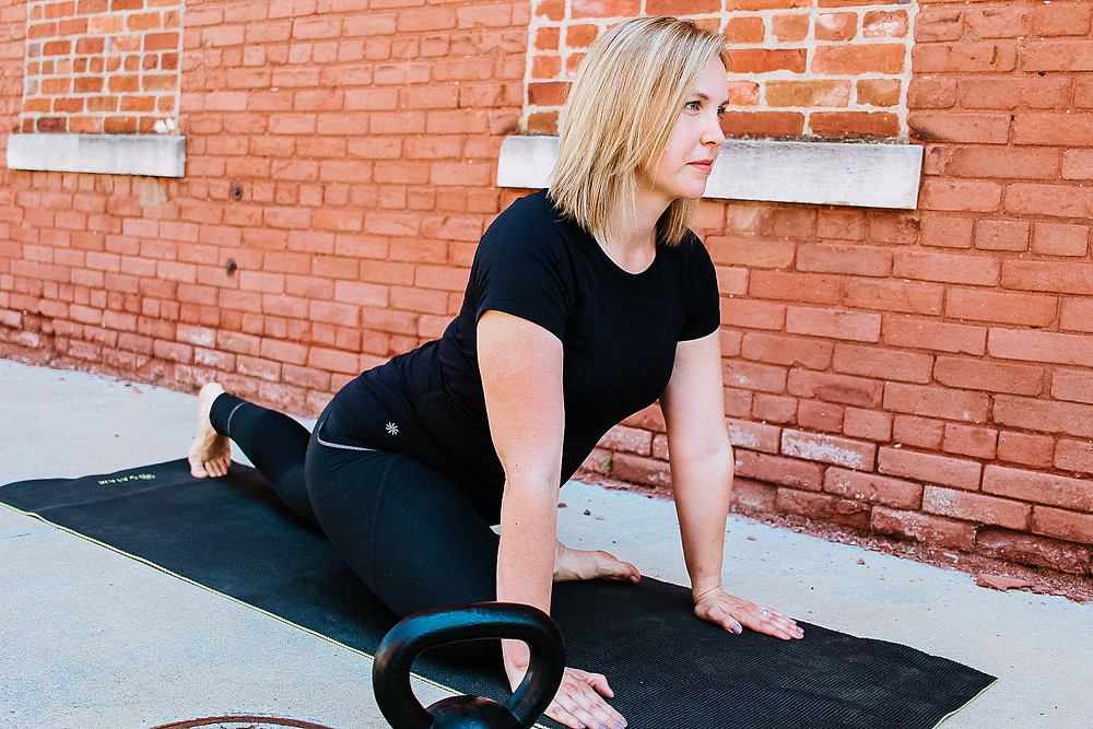 A woman doing strength and mobility exercises to help fight fatigue.