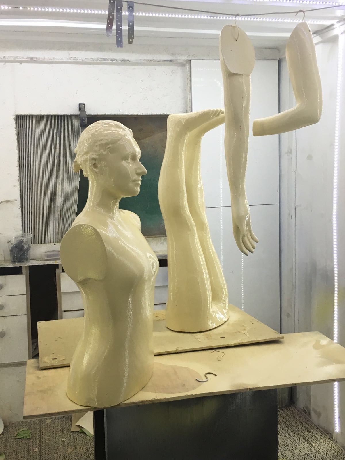 Milled figure coated in resin