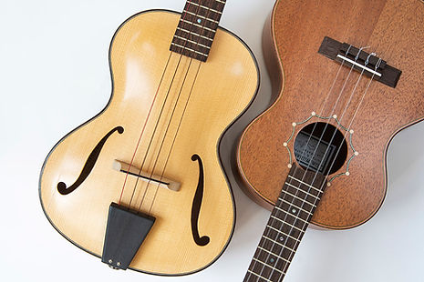 Close up of two handmade ukuleles