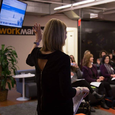 me raising hand front of room.jpg