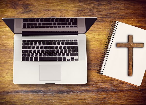Laptop with cross and notebook image.jpg