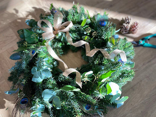 Christmas spruce wreath with peacock feathers
