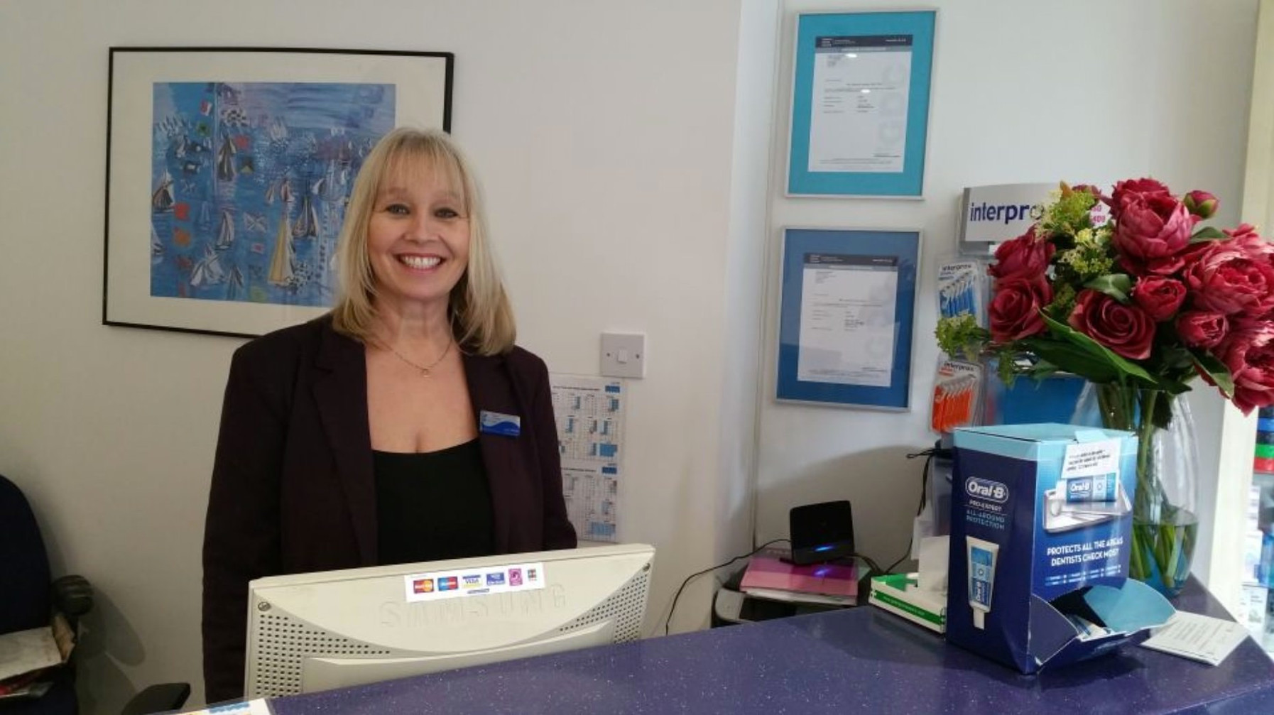 Laura, our Practice Manager, at reception