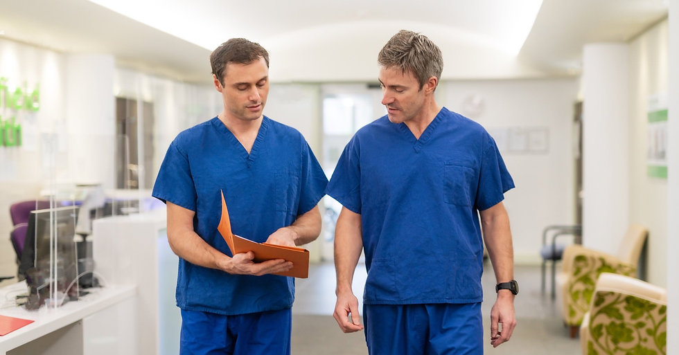Maxillofacial consultants in scrubs