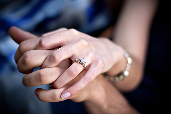 close-up-of-a-young-couples-hands-and-di