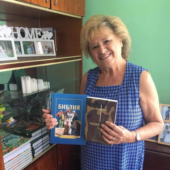 Sara Michalski with Bibles