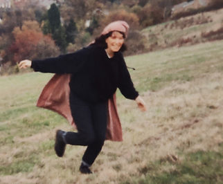 Lucinda Leo Gifted Young Adult Running In Coat On Hill   Gifted Coaching   Cognitive Hypnotherapy