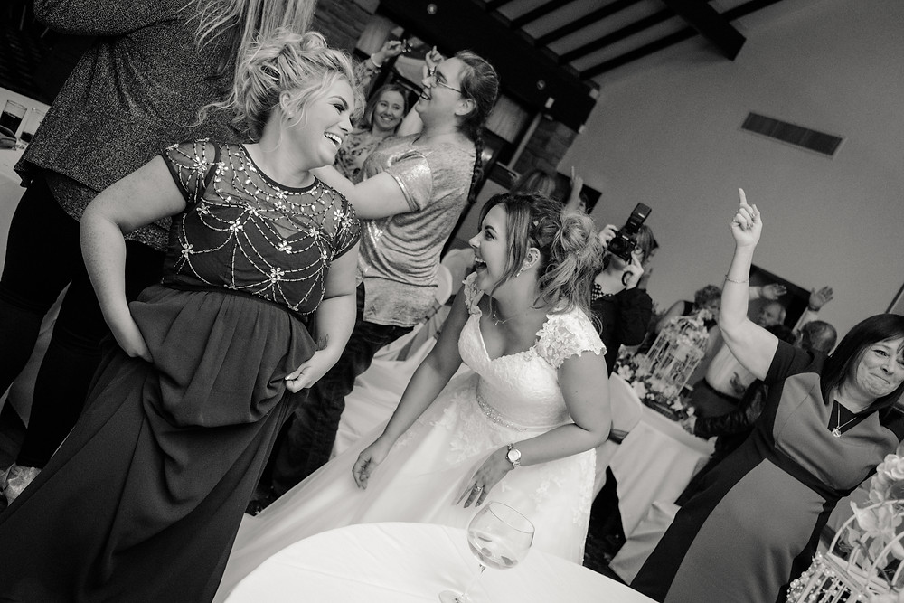Bride has a good hearty laugh with her bridesmaid, by Nessworthy Photography