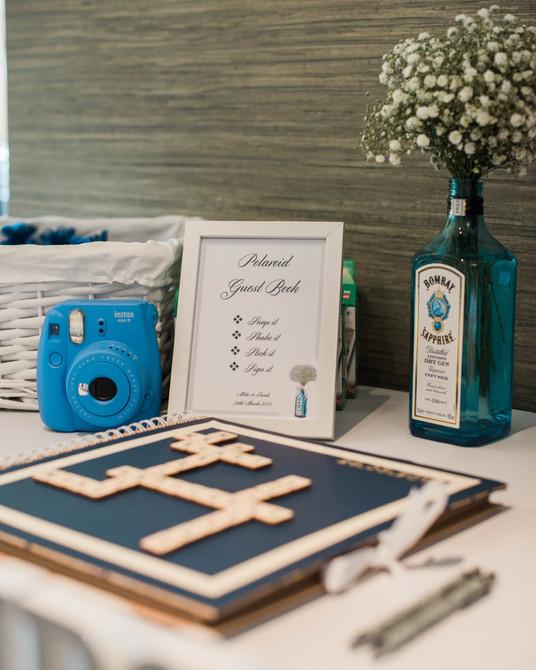 Alternative wedding details - Scrabble guest book, Bombay Sapphire and polaroid camera. Documentary wedding photography Warwickshire.