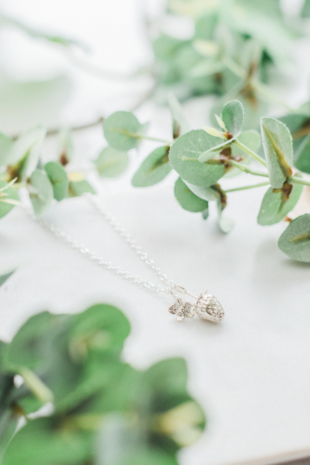 Lucy Flint Jewellery's strawberry pendant is beautifully crafted by a true artisan. Darley and Underwood Photography.