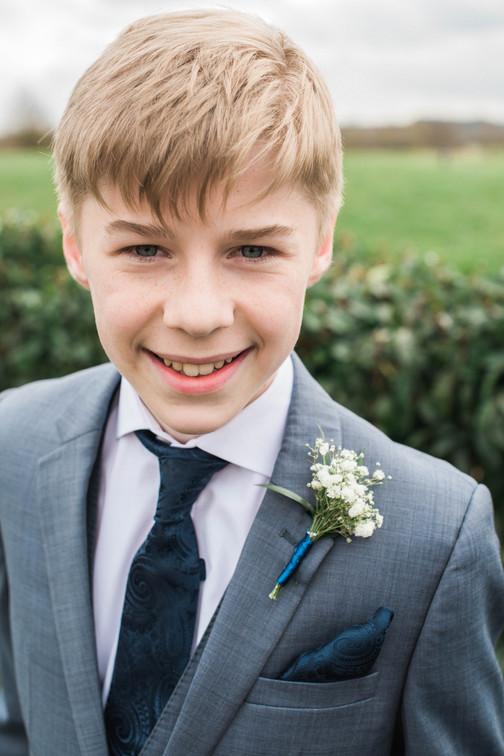 Page boy smile at Nottinghamshire wedding venue.