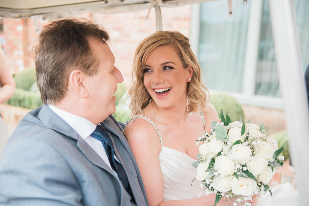 Bride and bouquet before the wedding with the father of the bride. Leicestershire wedding photographer.
